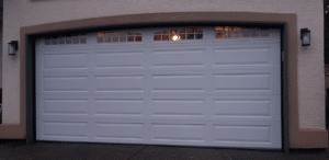 a new garage door with top section of glass